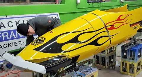 Painting the men's and women's two-man bobsleighs became part of the busy bodyshop's daily routine