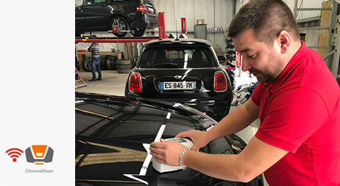 Frédéric Molimard, co-owner of Carrosserie Pavard, takes colour readings with ChromaVison Pro