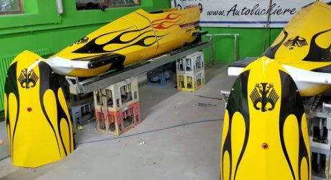 After carefully applying the paint, the bobsleighs were ready to race at the Olympic Games